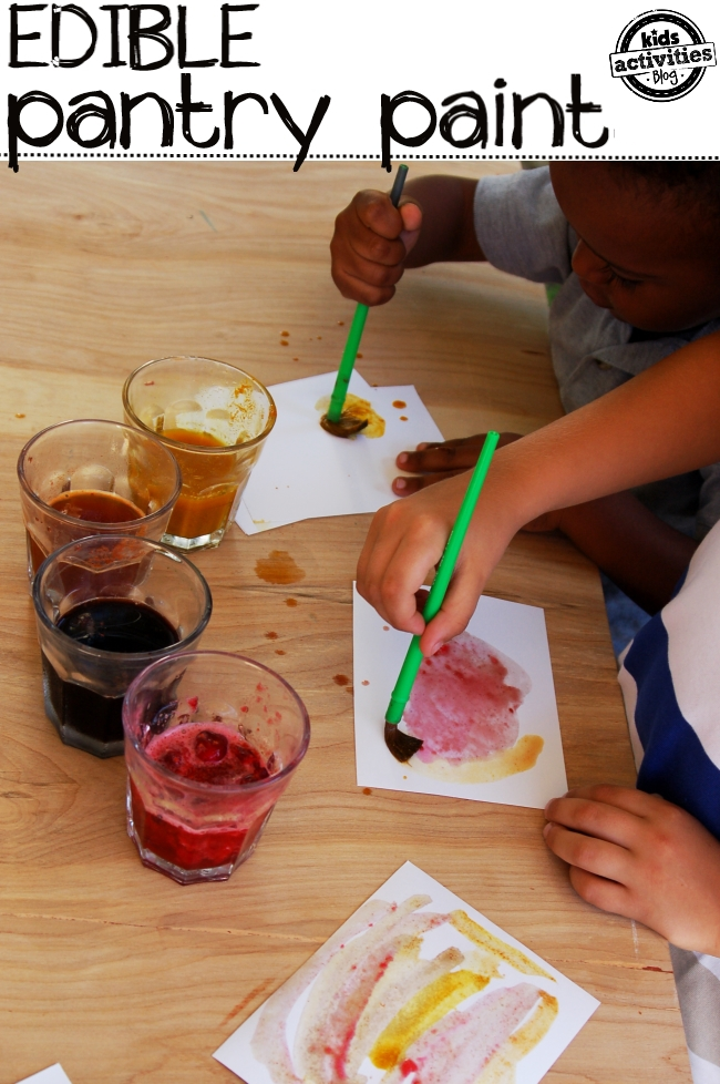 Spice paint recipe - edible paint recipe for kids to learn about colors and tastes - shown are two kids painting pictures with homemade spice paint