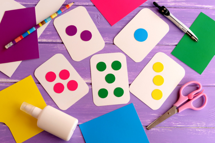 homemade flash card set shown on table with blank playing cards and dot stickers