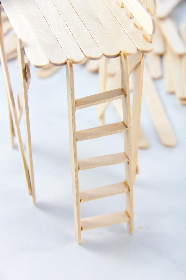 A popsicle stick ladder for a fairy garden observation deck