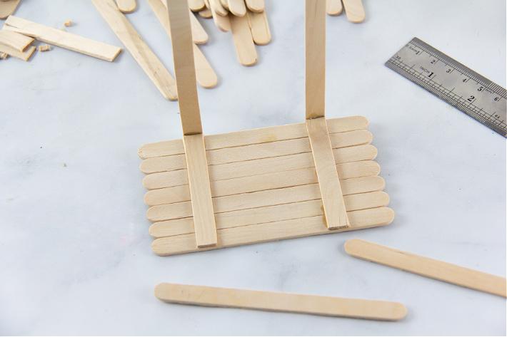 popsicle sticks being glue together