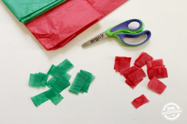 tissue paper is cut into small squares to fill in the free printable mexican flag