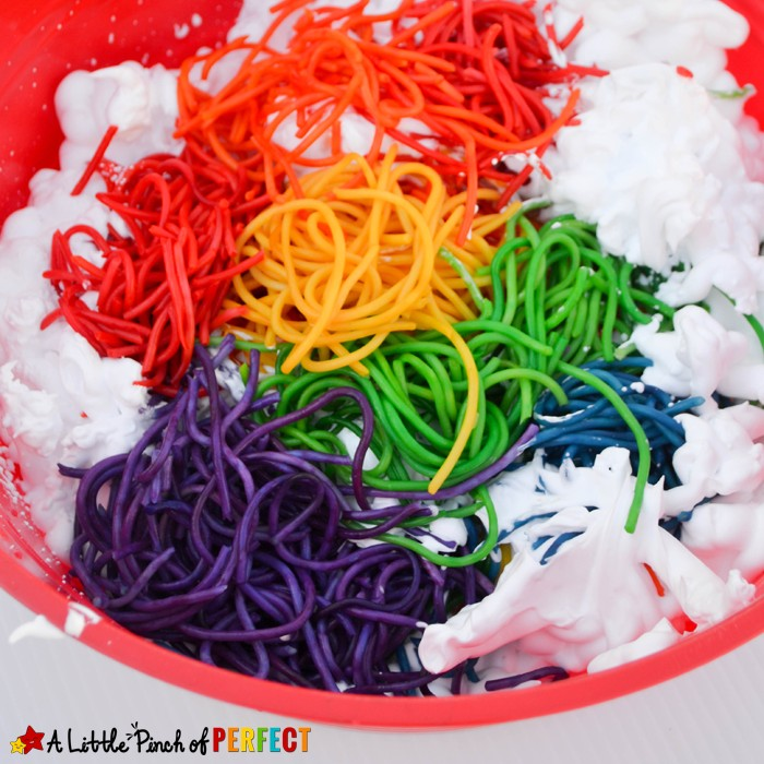 sensory bin from A Little Pinch of Perfect that has colored spaghetti noodles and shaving cream