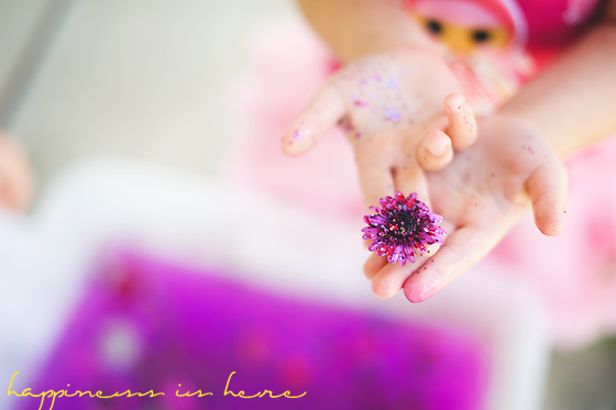 colored water and fresh flower sensory bin from Happiness is Here