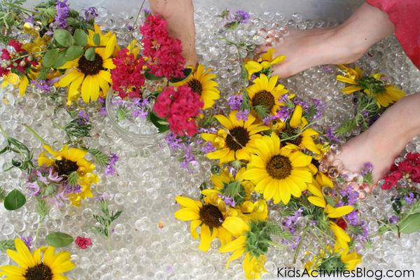 water bead sensory bin wit fresh flowers from Kids Activities Blog