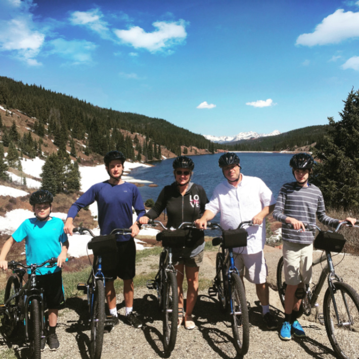Bike Tour on the Vail Pass - Kids Activities Blog - Family with bikes at the top of the Vail Pass