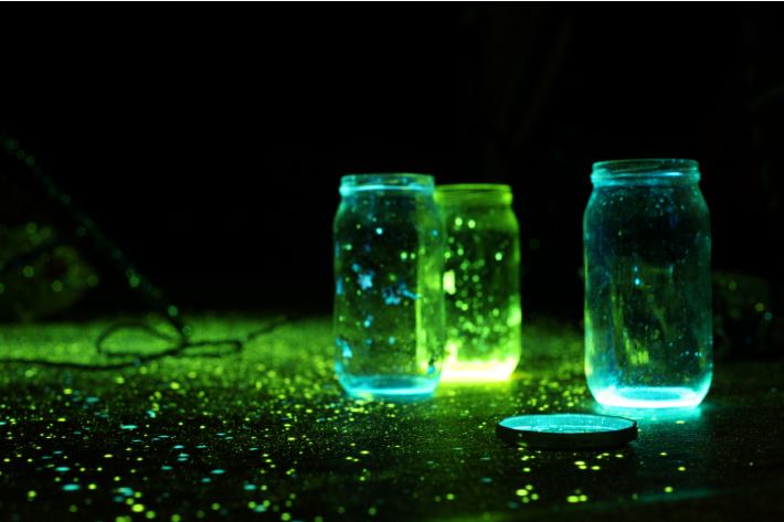 Glow Powder around and inside of jars in the dark - Kids Activities Blog
