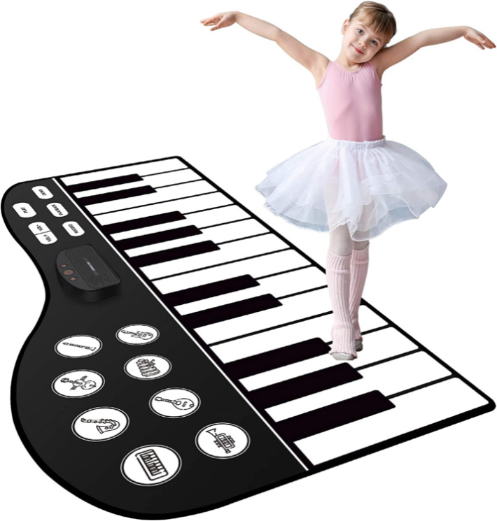 M Sanmersen Piano Keyboard Mat for Children with Child Pictured - Image via Amazon