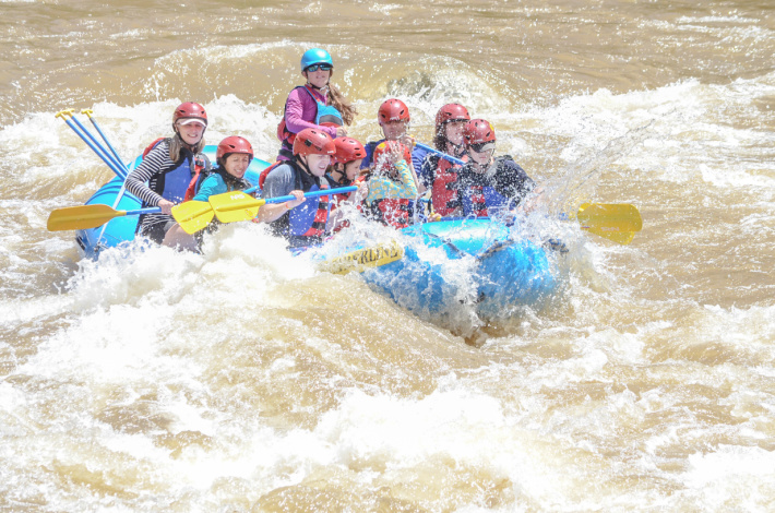 White water rafting on the Colorado River in the Vail Valley - Kids Activities Blog - 2 families on a raft on the Colorado River