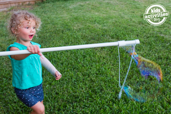 pvc project - make a bubble wand to make giant bubbles from Kids Activities Blog