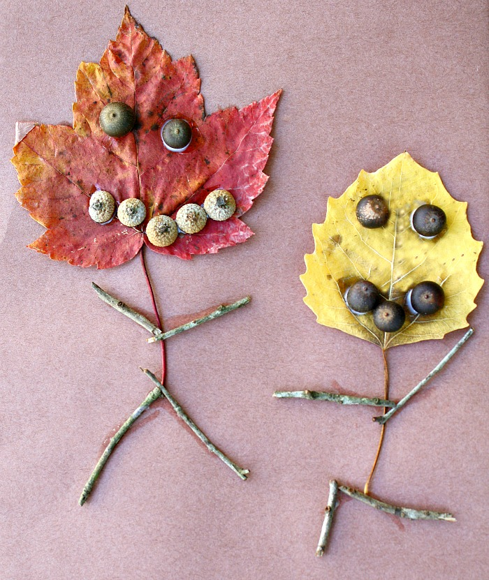 Leaf people craft for kids - two leaves crafted to look like people with stick bodies and acorn eyes from Fantastic Fun and Learning