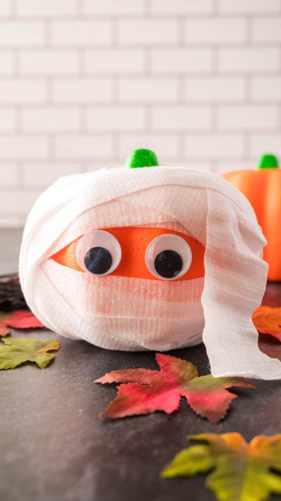 DIY no-carve mummy pumpkins