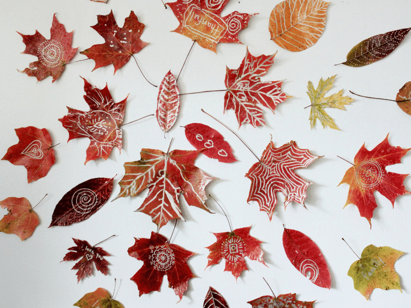 leaf mandala crafts for kids shown with gold and silver metallic leaf art from Artful Parent