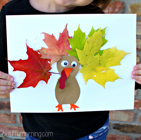 Leaf turkey craft for kids from Crafty Morning.  Finished leaf turkey show held by child