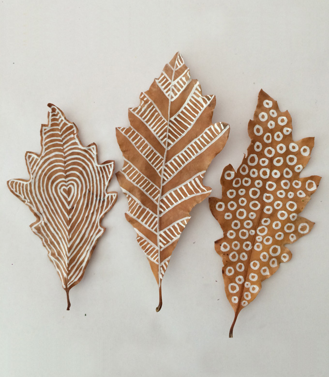 Oak leaves with chalk marker drawings on them - three leaf crafts shown from  Art Bar Blog