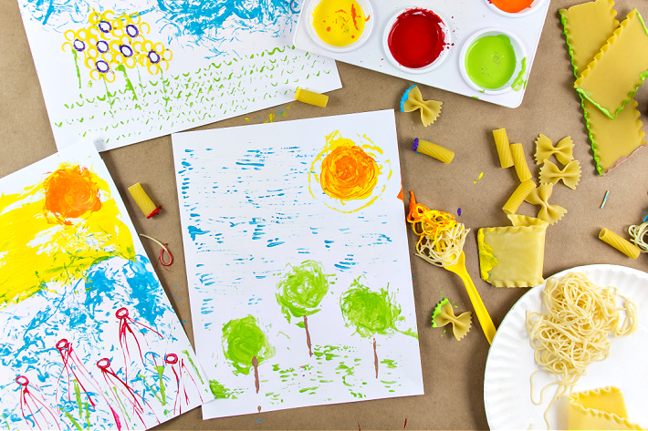 Cooked and uncooked pasta used to make art with kids