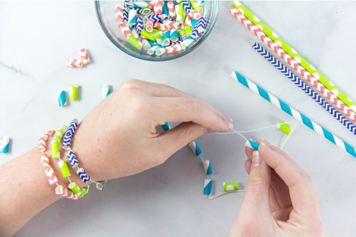 using fishing wire or other types of string for straw bead jewelry with kids - Kids Activities blog